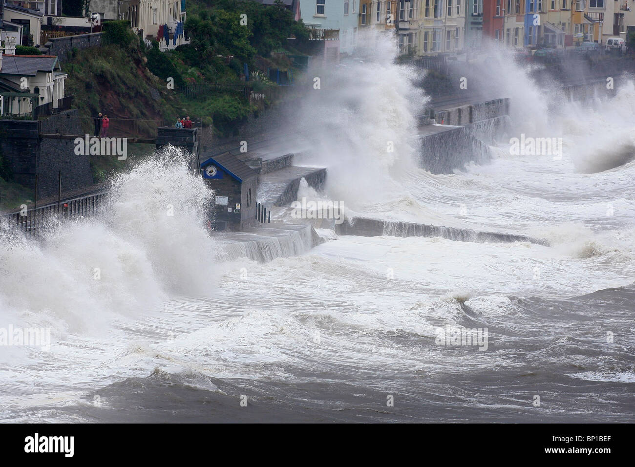 Huge waves crash over the sea wall and railway line at Dawlish in Devon. Picture by James Boardman Stock Photo