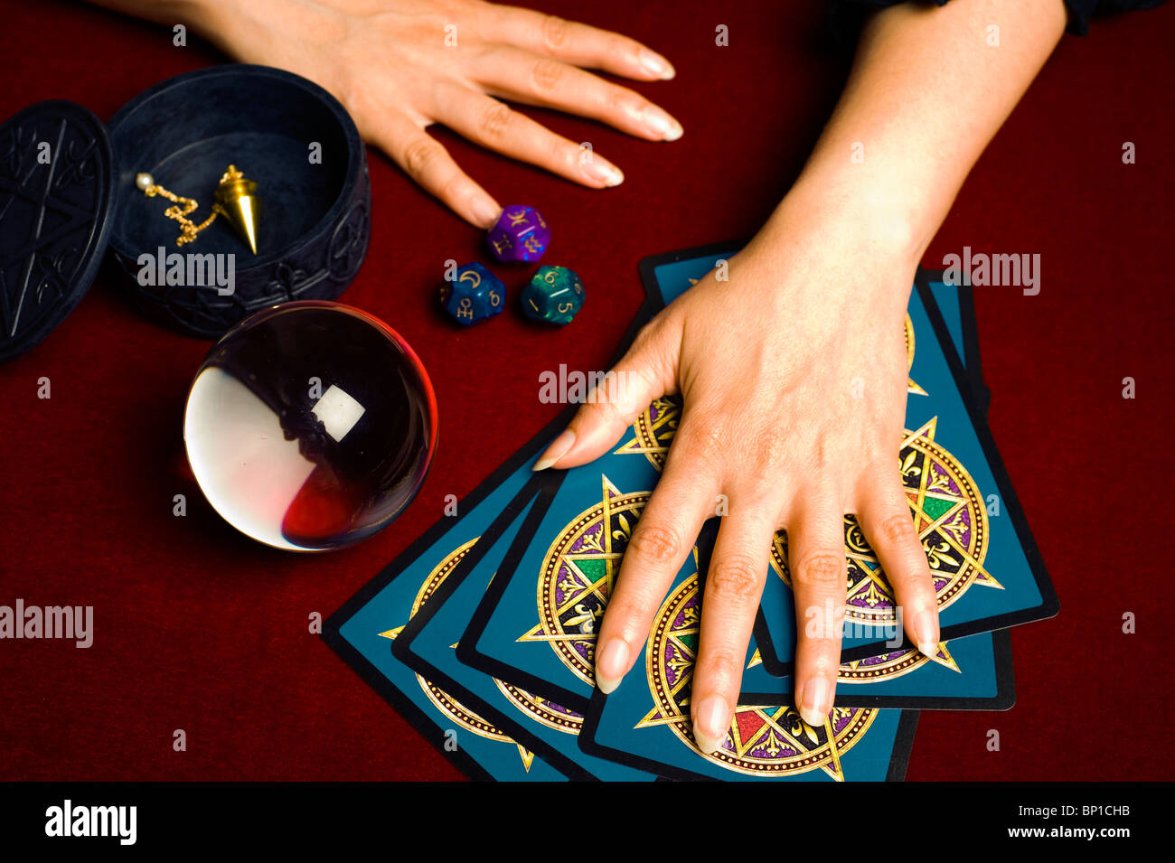 fortune teller during a magic ritual and tarot reading - Stock Image