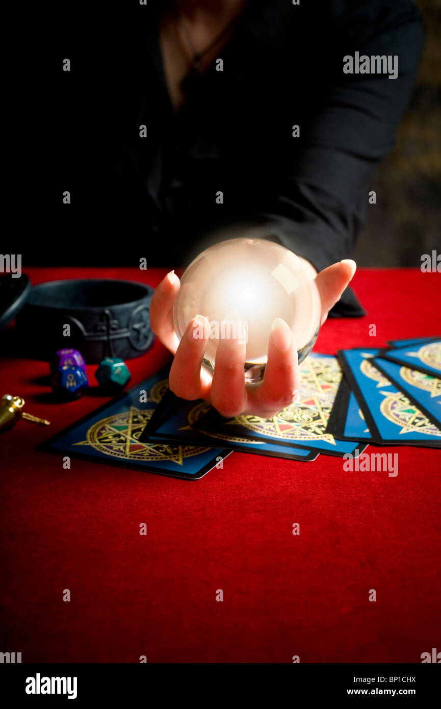 fortune teller during a tarot reading with crystal ball - Stock Image