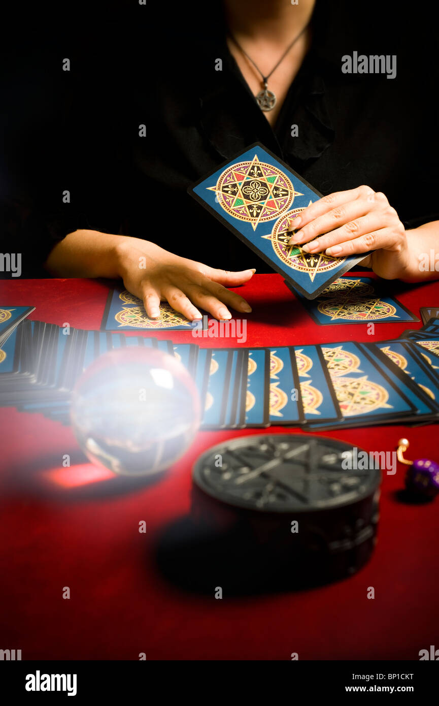 fortune teller during a tarot reading - Stock Image