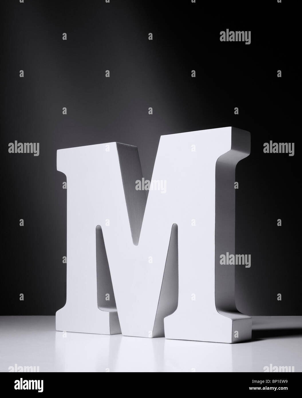 The letter M as a block model on a graded background - Stock Image