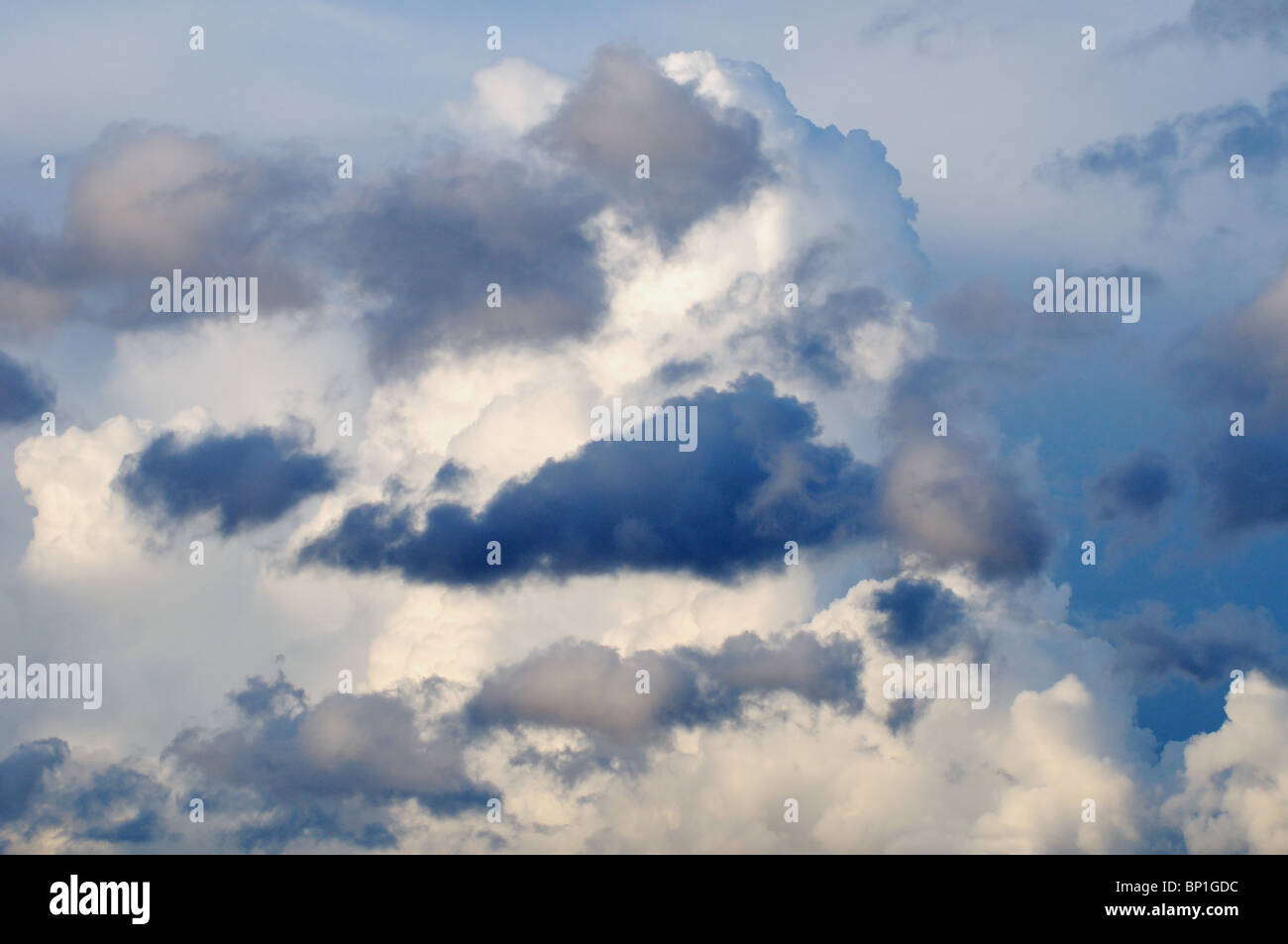 Storm clouds forming against dark background - Stock Image