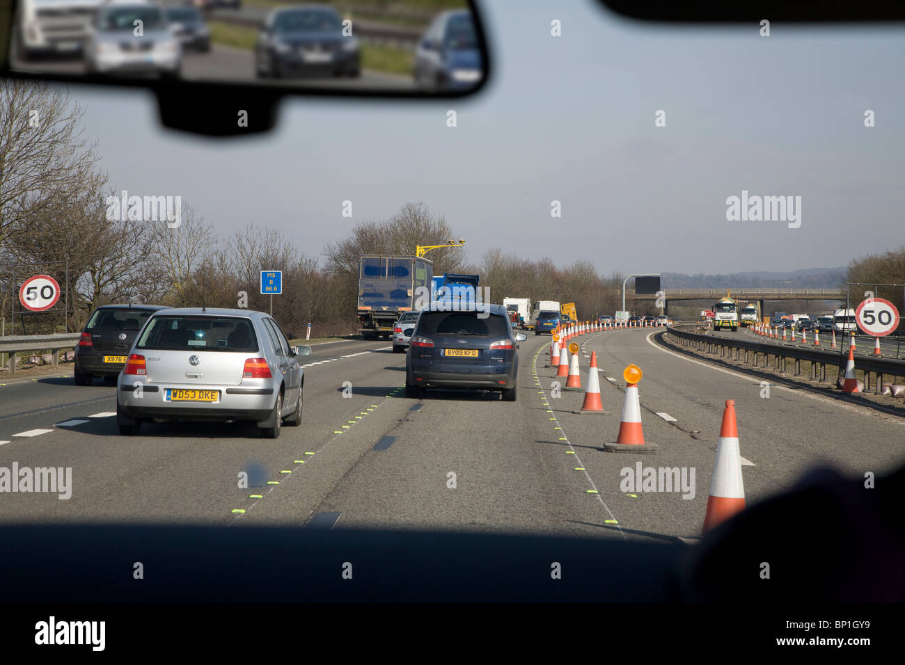 MOTOR WAY ROAD WORKS WITH TRAFFIC CONES TAKEN THROUGH WINDSCREEN M5 ENGLAND UK - Stock Image
