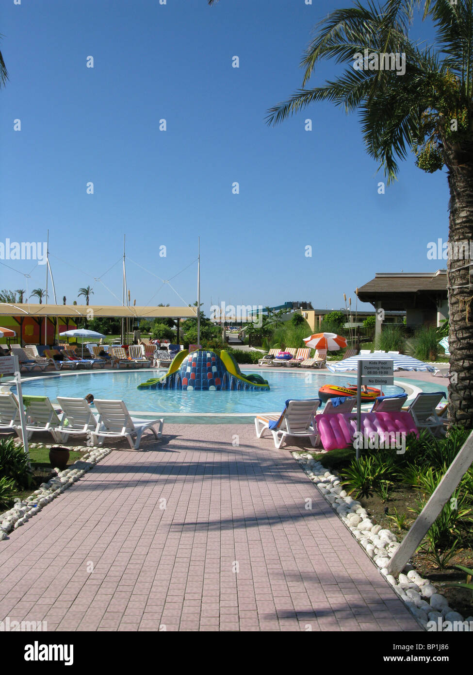 empty kids pool in holiday complex - Stock Image