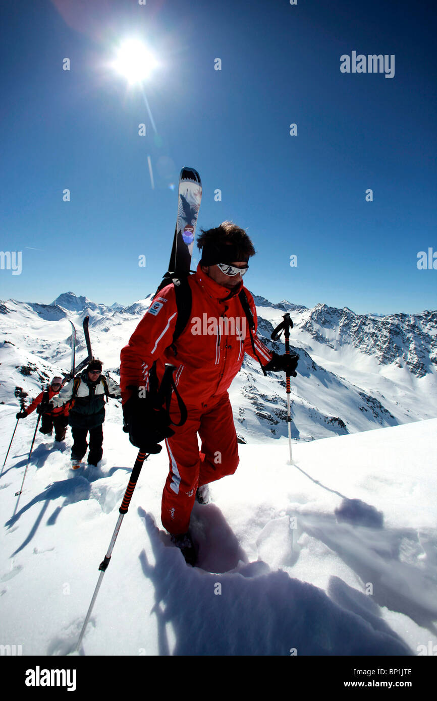 France, Alps, Savoie, Méribel-Mottaret, off piste skiers walking - Stock Image