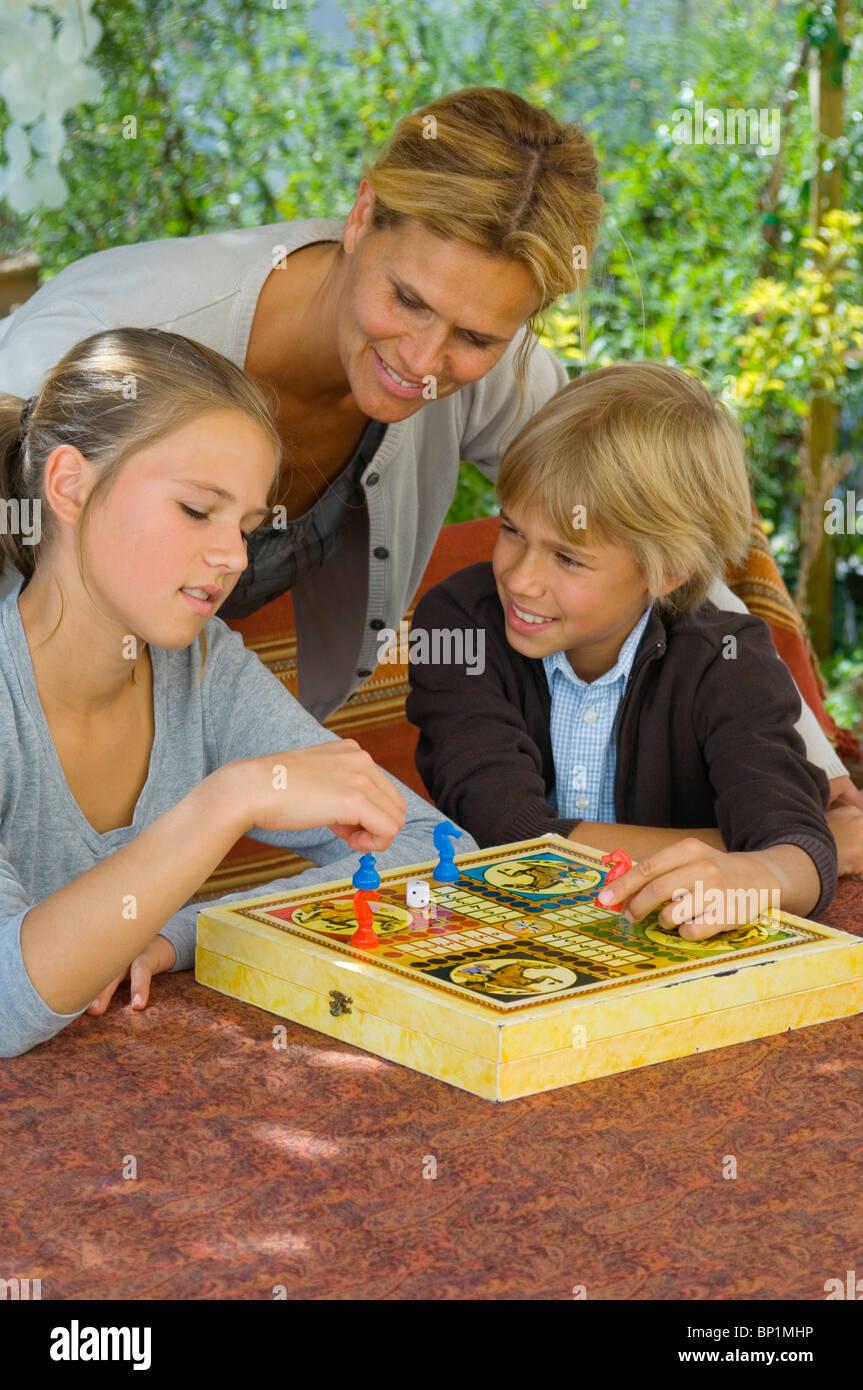 Family playing ludo Stock Photo