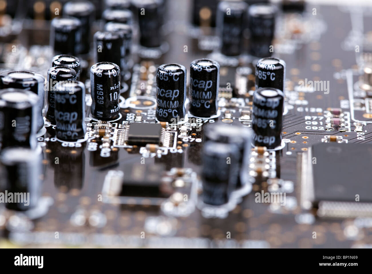 Closeup of an electronic board, capacitors - Stock Image