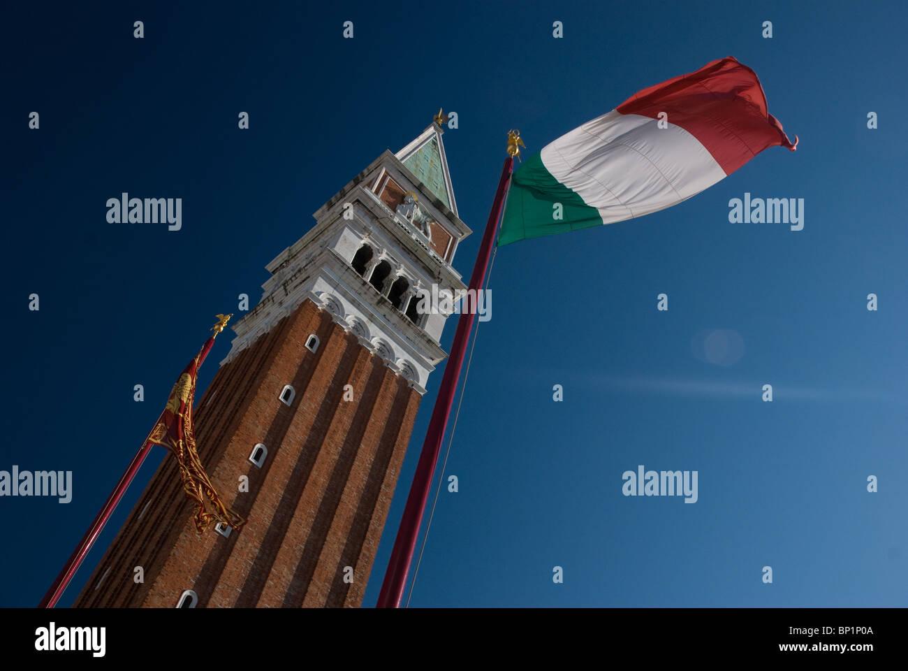 Italian flag and Campanile, St Mark's Square, Venice, Italy - Stock Image