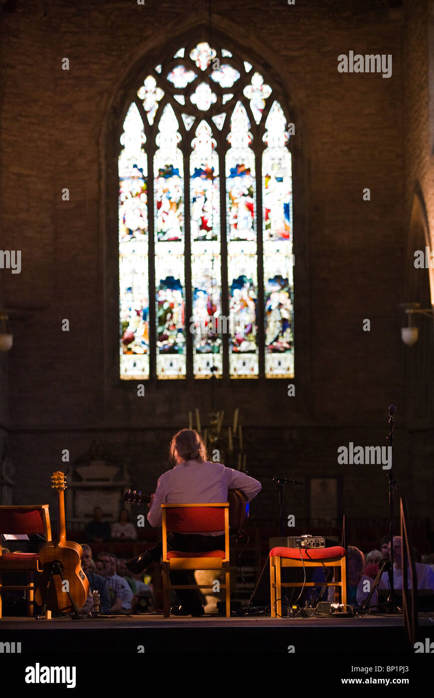 Roland Chadwick guitarist playing the blues on stage in the Cathedral during Brecon Jazz Festival 2010 - Stock Image