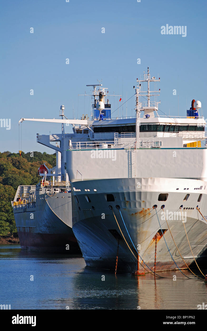 cargo ships and tankers laid up in deep water on the river fal near truro in cornwall, uk - Stock Image
