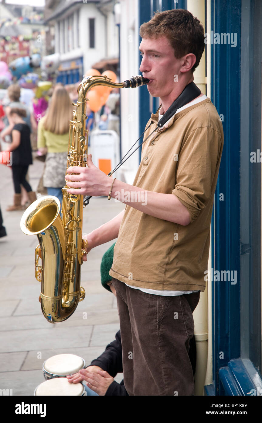 A young busker on the Streets of brecon  with a saxaphone at the Jazz Festival weekend 2010 - Stock Image
