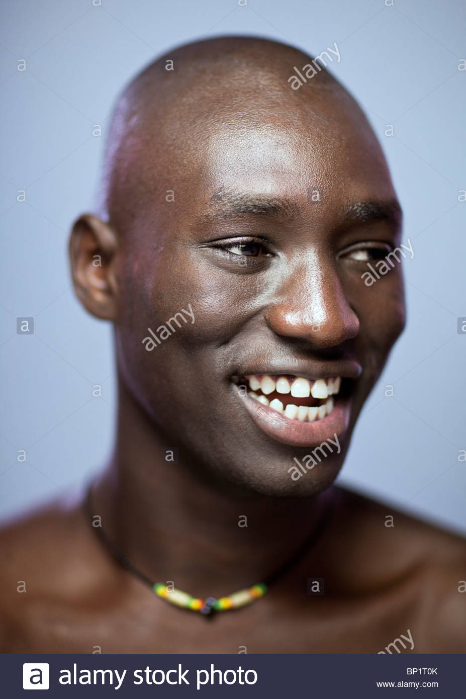Close-up Portrait of African Man Smiling - Stock Image