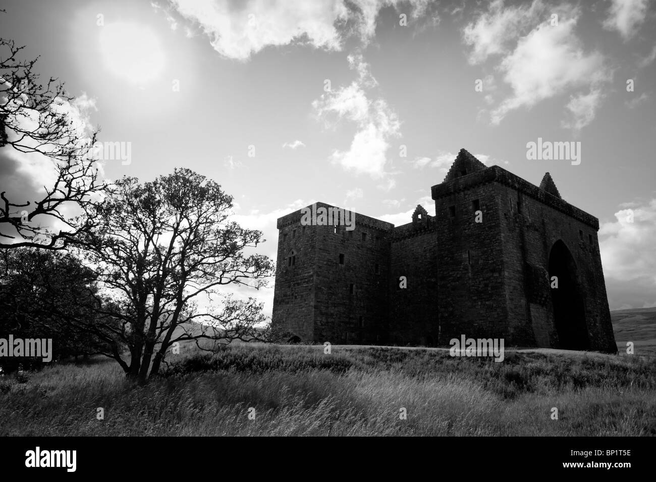 Hermitage Castle on the Scottish Border - a foreboding and dark stone tower almost without windows - Stock Image