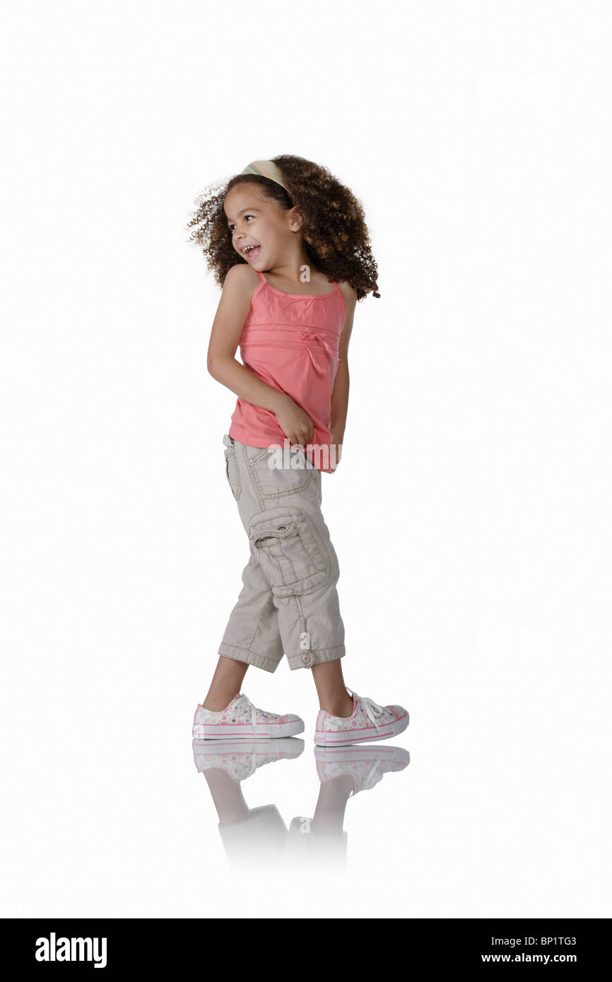 Young Girl on White Looking Back Over Shoulder - Stock Image