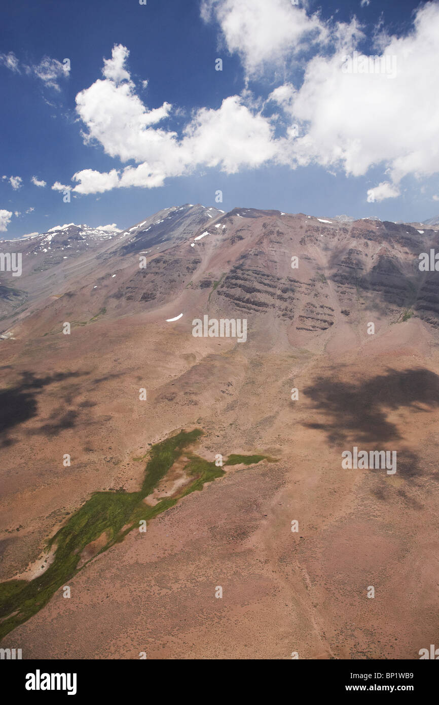Green Grass from Water Seepage, High in Andes Mountains, near Santiago, Chile, South America - aerial - Stock Image