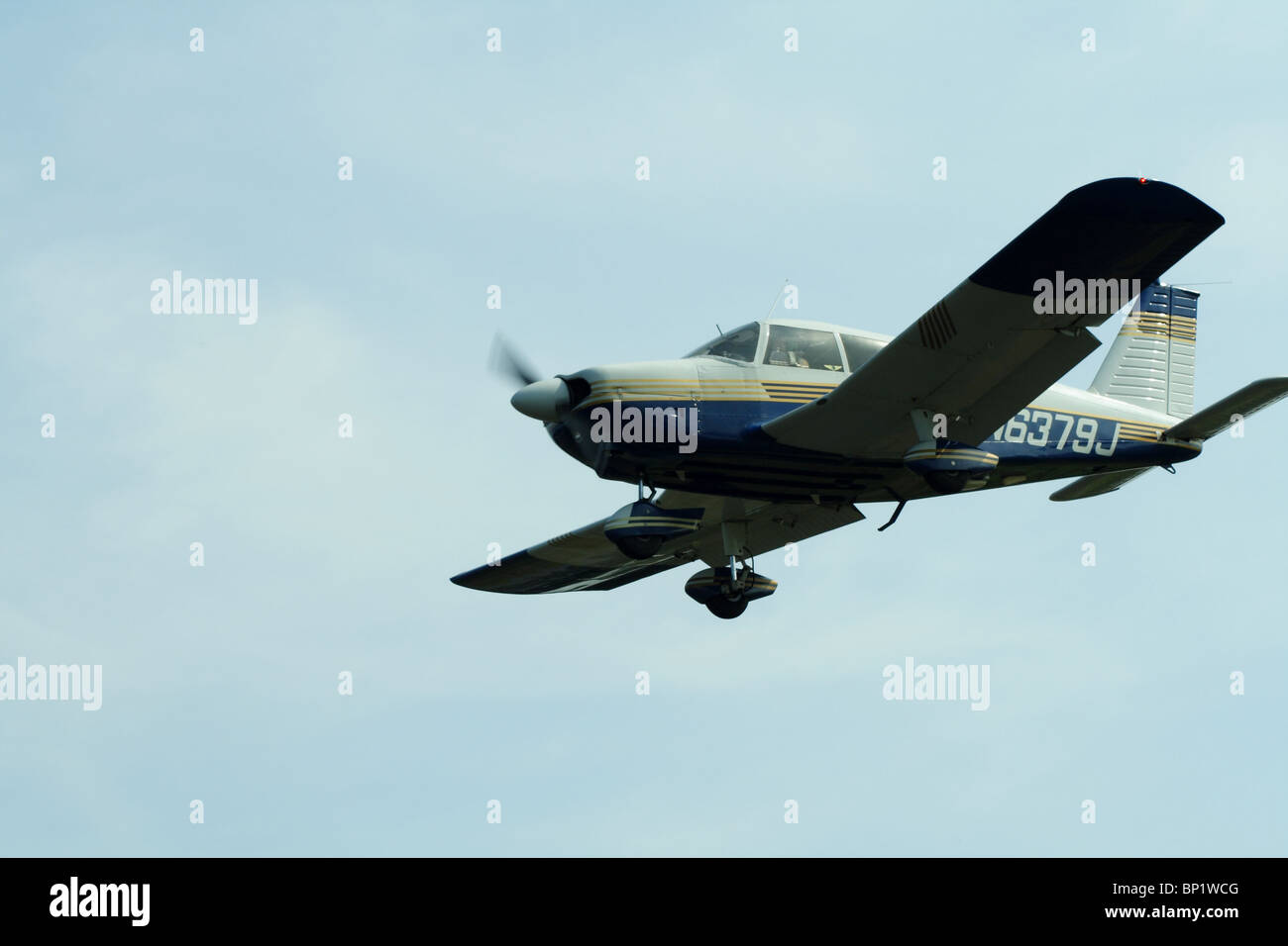 Prop plane Piper PA-28-180 on final approach landing at Cantrell Field in Conway, Arkansas - Stock Image