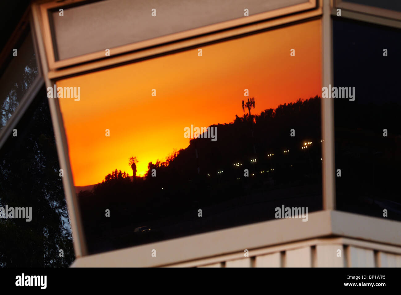 Sunset Reflected in Control Tower, Vitacura Airfield, Santiago, Chile, South America - Stock Image