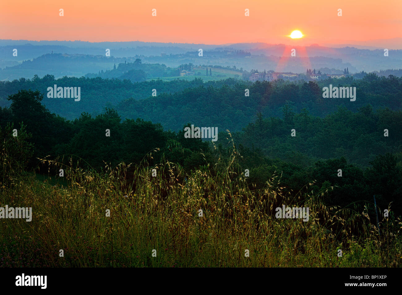 The hilly landscape surrounding the town of San Gimignano in Tuscany, Italy - Stock Image
