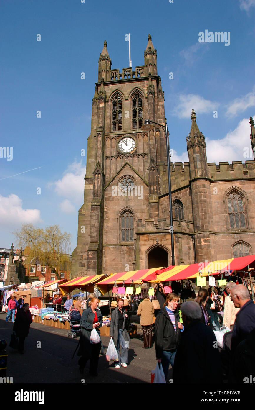England, Cheshire, Stockport Market Place, St Mary's Parish Church on market day - Stock Image