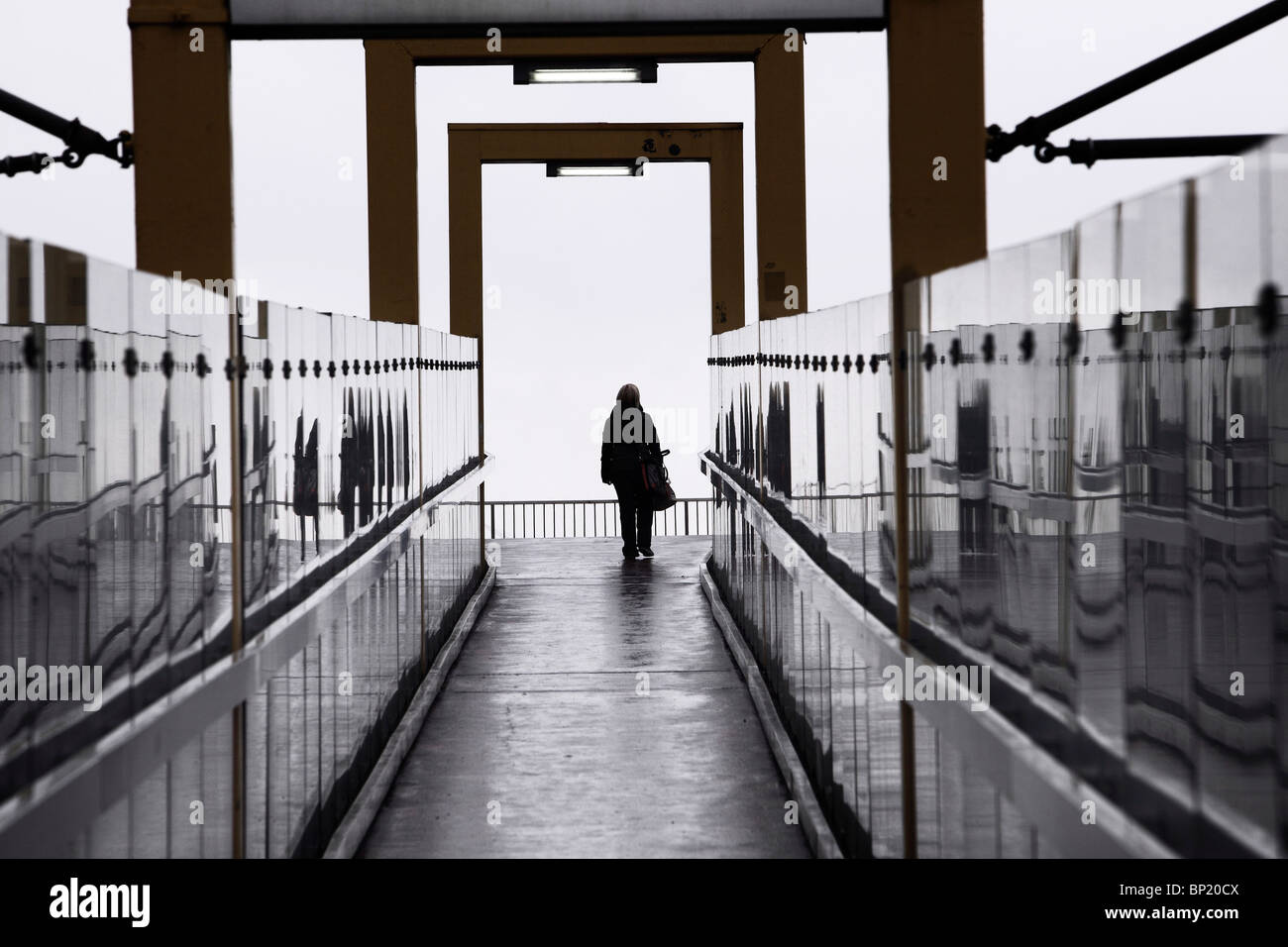 Exit of a subway station. One single person is leaving the walk way. Germany. - Stock Image