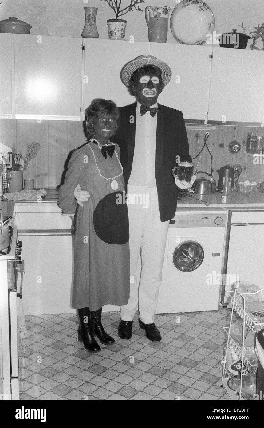 Blacked up and dressed as the Black and White Minstrels 1980s Blackface couple fancy dress Christmas party west - Stock Image
