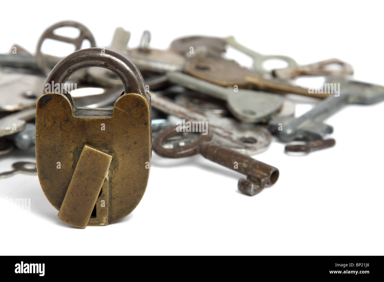 Old padlock and heap of keys isolated on white Stock Photo