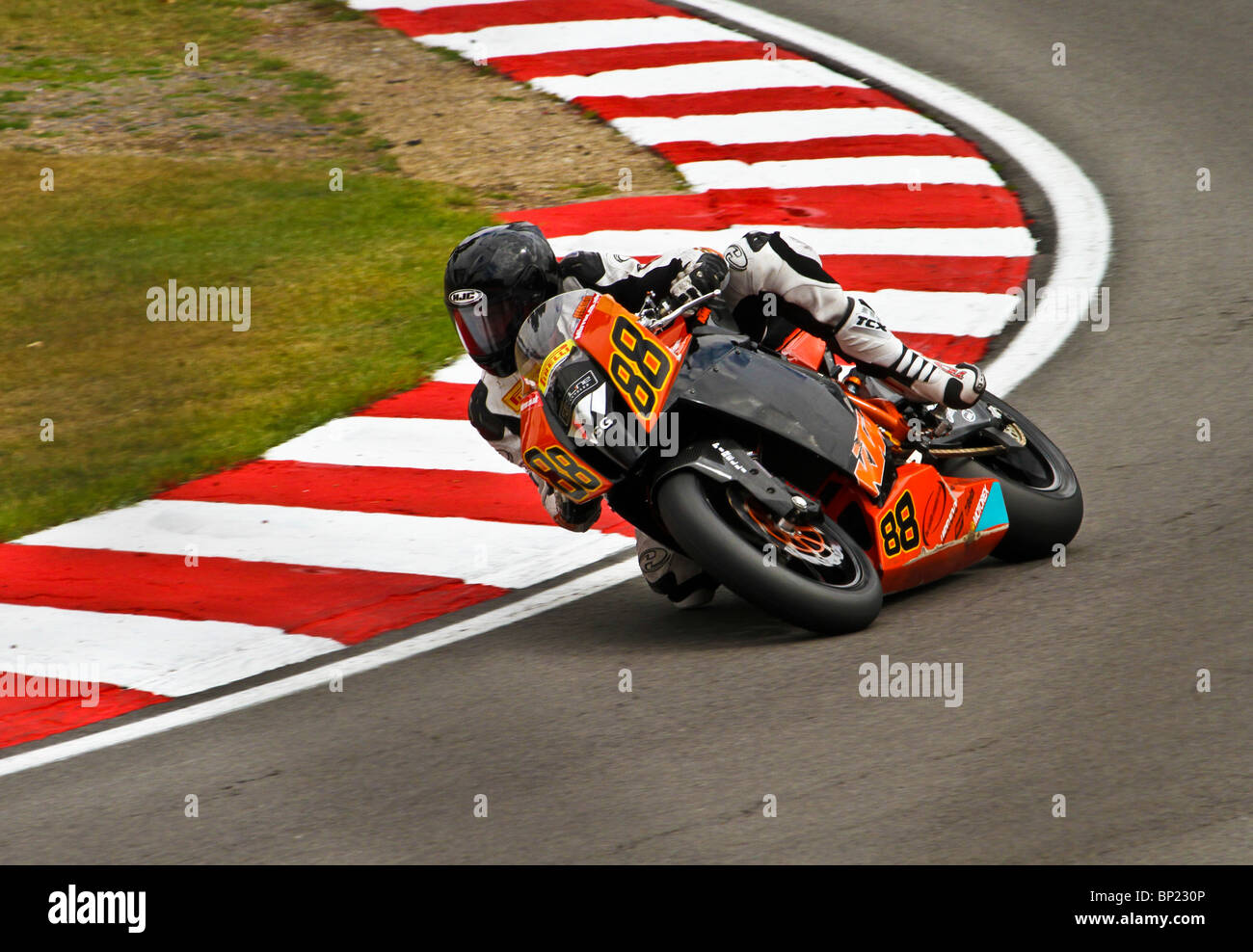 James EDMEADES of Redline KTM leans into a corner on the historic GP circuit at Brands Hatch, Kent. - Stock Image