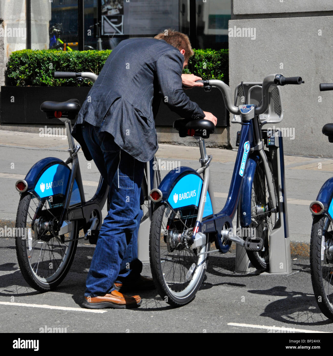 London user returning collecting hire bike - Stock Image