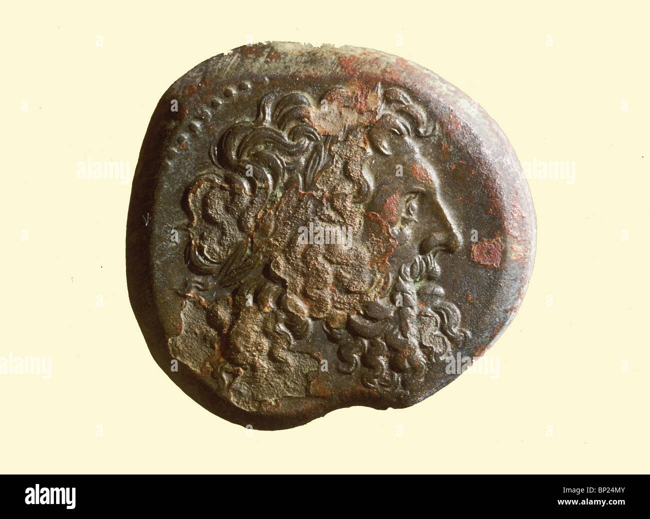 600. HELENISTIC COIN WITH THE BUST OF ZEUSS FROM THE TIMES OF PTOLEMAUS I. - Stock Image