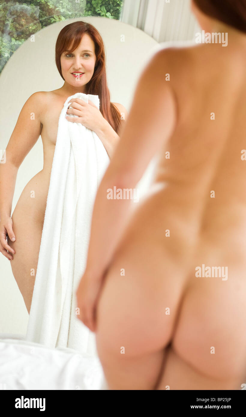 Young Topless Woman Standing In Front Of Mirror And Covering Breast With Arms People, Arms Crossed
