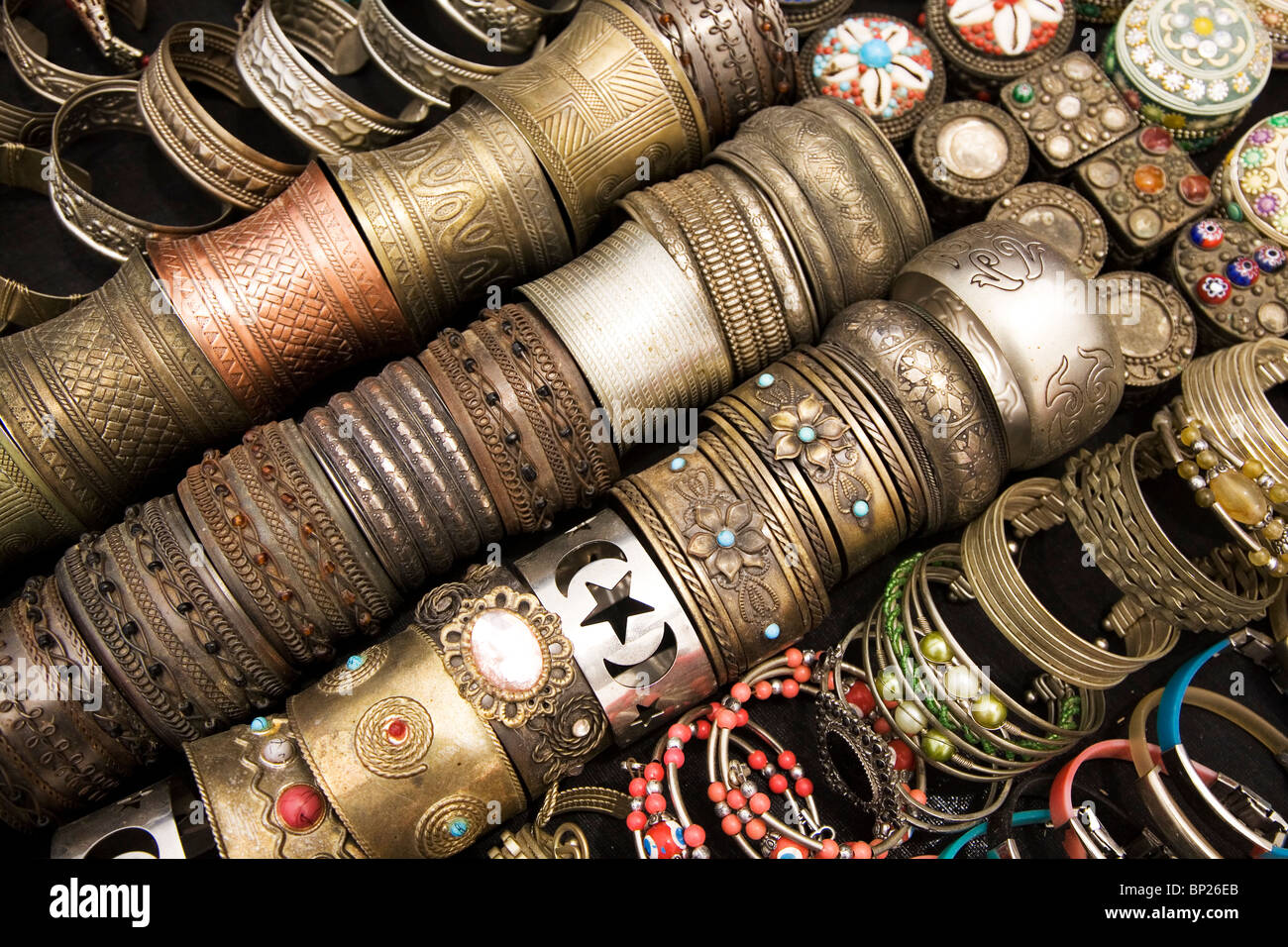 Bracelets are sold as souvenirs a market stall at Houmt Souk in Djerba, Tunisia. - Stock Image