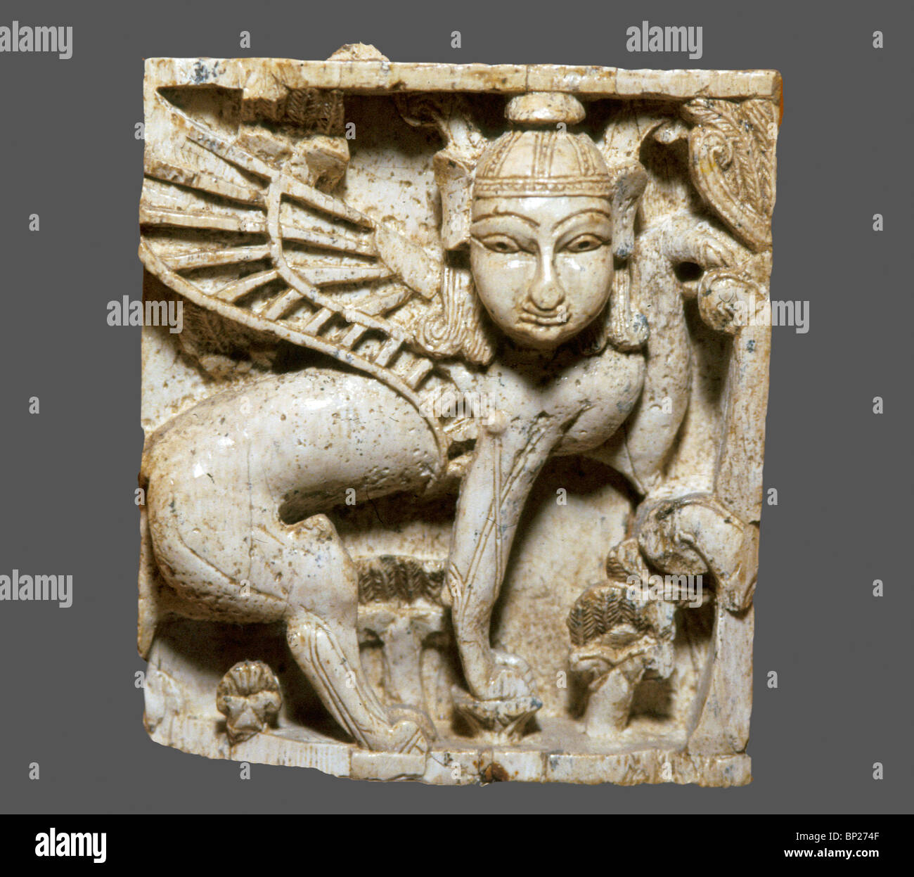 1458. PHOENICIAN IVORY PLATE, CARVING OF A WINGED SPHINX, C. 9TH C. BC. - Stock Image