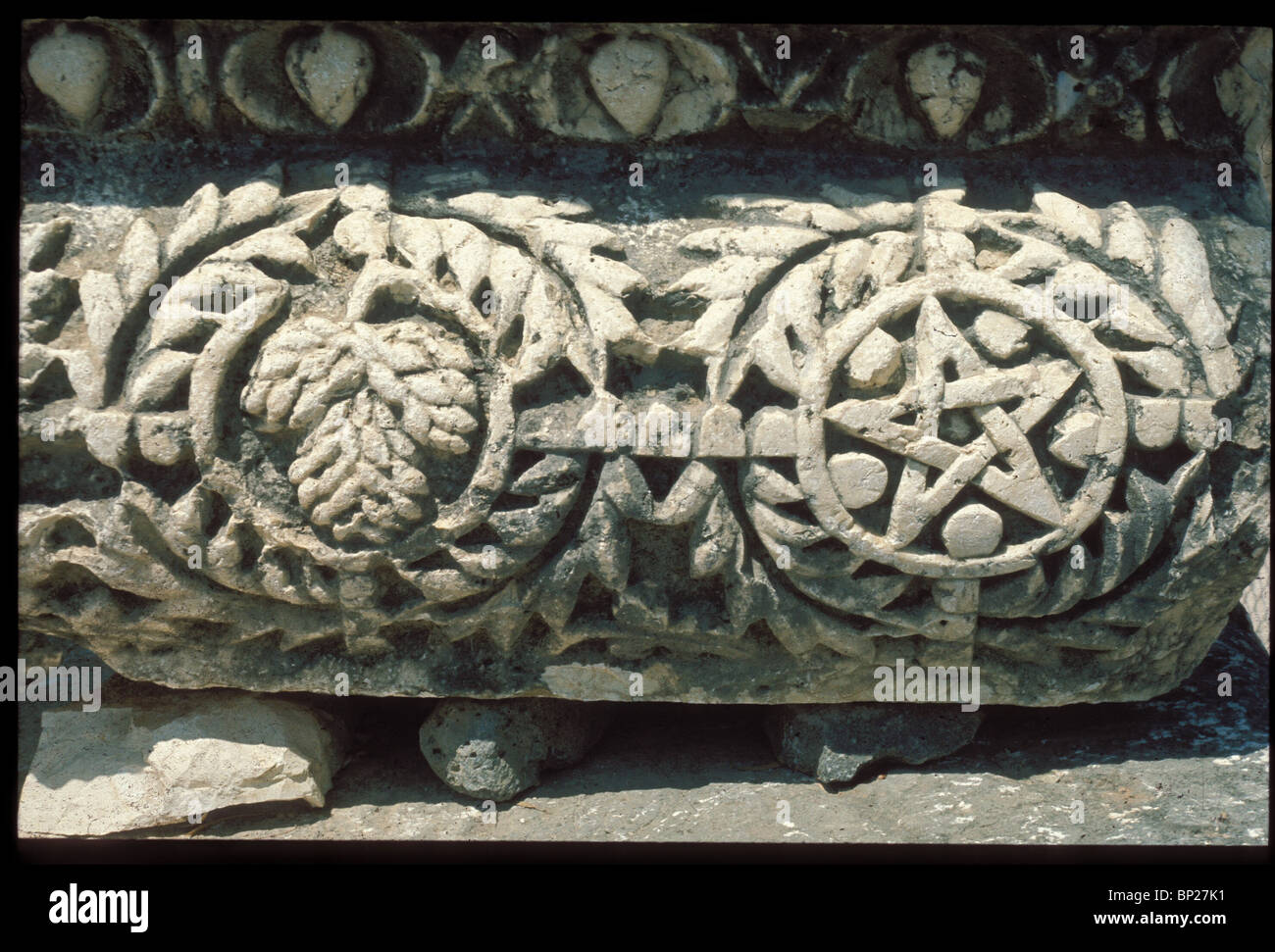 888. CAPERNAUM - ARCHITECTURAL DETAILS, AND STONE CARVINGS FROM THE ANCIENT SYNAGOGUE - Stock Image