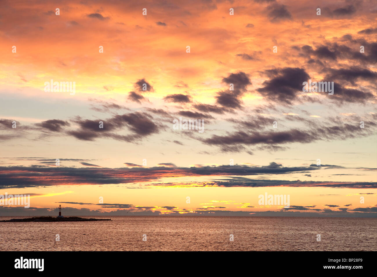 croatia - colorful sky and clouds after sunset over adriatic sea - Stock Image