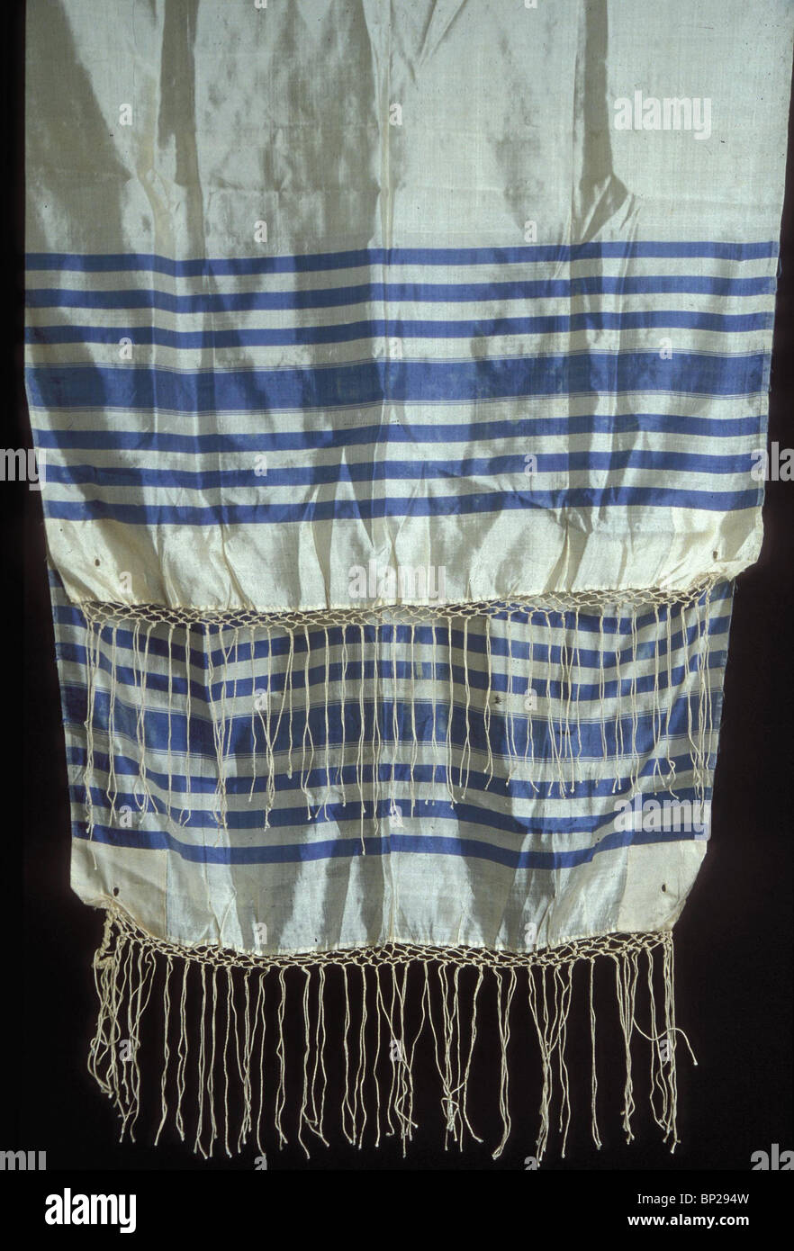 TALLIT - PRAYER SHAWL WORN BY JEWISH MALES DURING PRAYER & IN THE SYNAGOGUE. WEARING THE TALLIT COMPLIES WITH - Stock Image