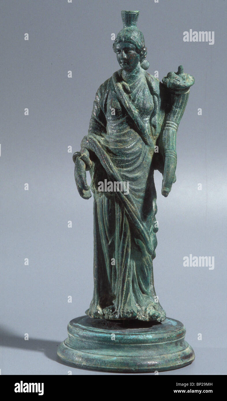 BRONZE FIGURINE OF THE ROMAN GODDESS FORTUNA HOLDING THE 'HORN OF PLENTY' A SYMBOL OF FORTUNE & WEALTH. - Stock Image
