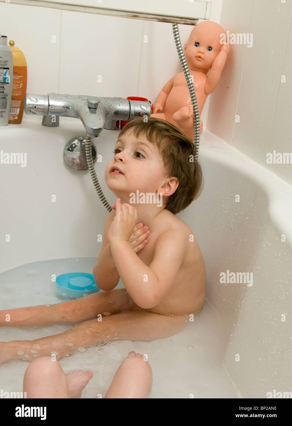 Emile - 2 and 1/2 - preting shaving like his dad - Stock Image