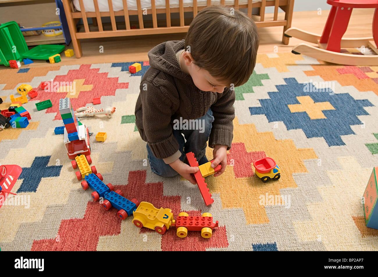 Emile playing with Lego - Stock Image