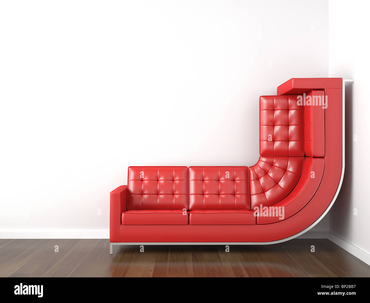 interior design with a bended red couch in a corner white room climbing up the wall with plenty copy space. - Stock Image