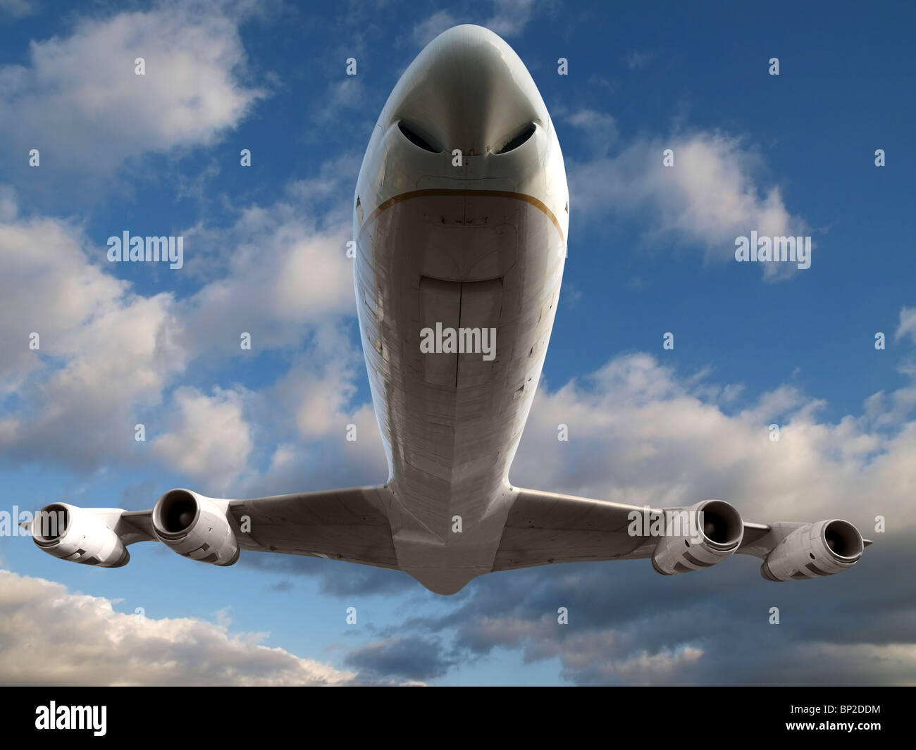 Low flying commercial aviation jet aircraft with soft clouds. - Stock Image
