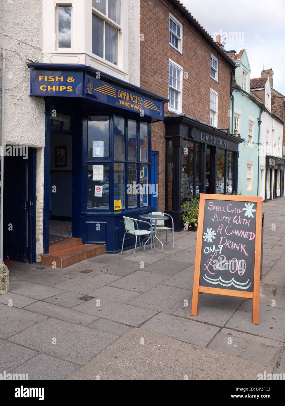 Fish and Chip shop in Yarm High Street with a sign for 'Chip Butty and a canned drink' - Stock Image