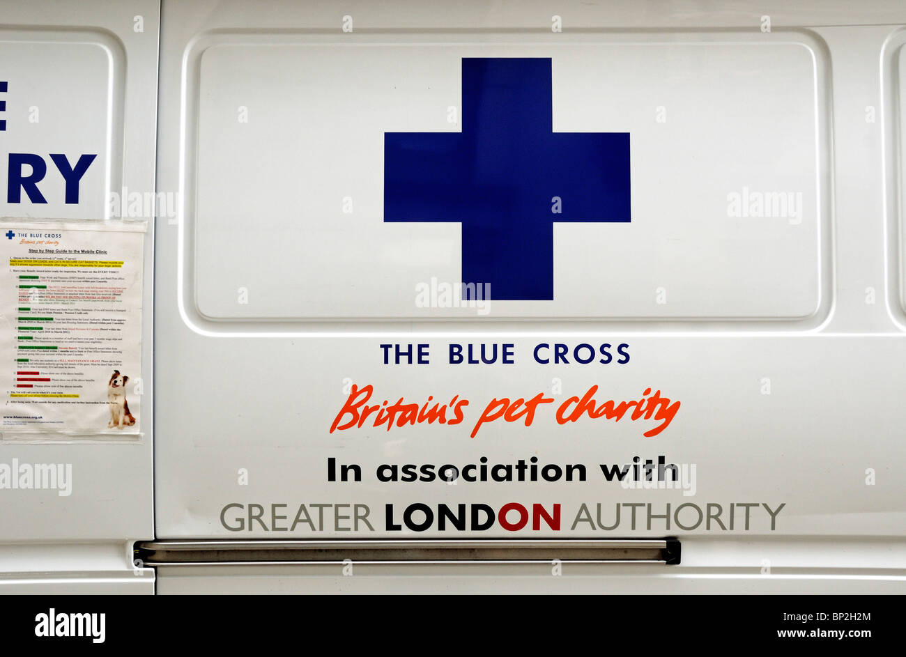 The Blue Cross sign on side of mobile van - Stock Image