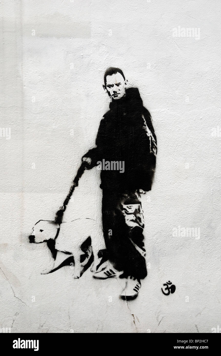 Graffiti Islington, Youth with Staffie - Stock Image