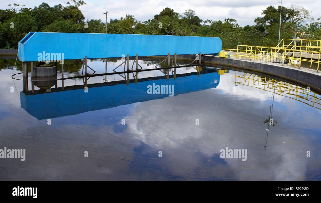 Sludge scraper bridge over a clarifier on a WWTP Stock Photo