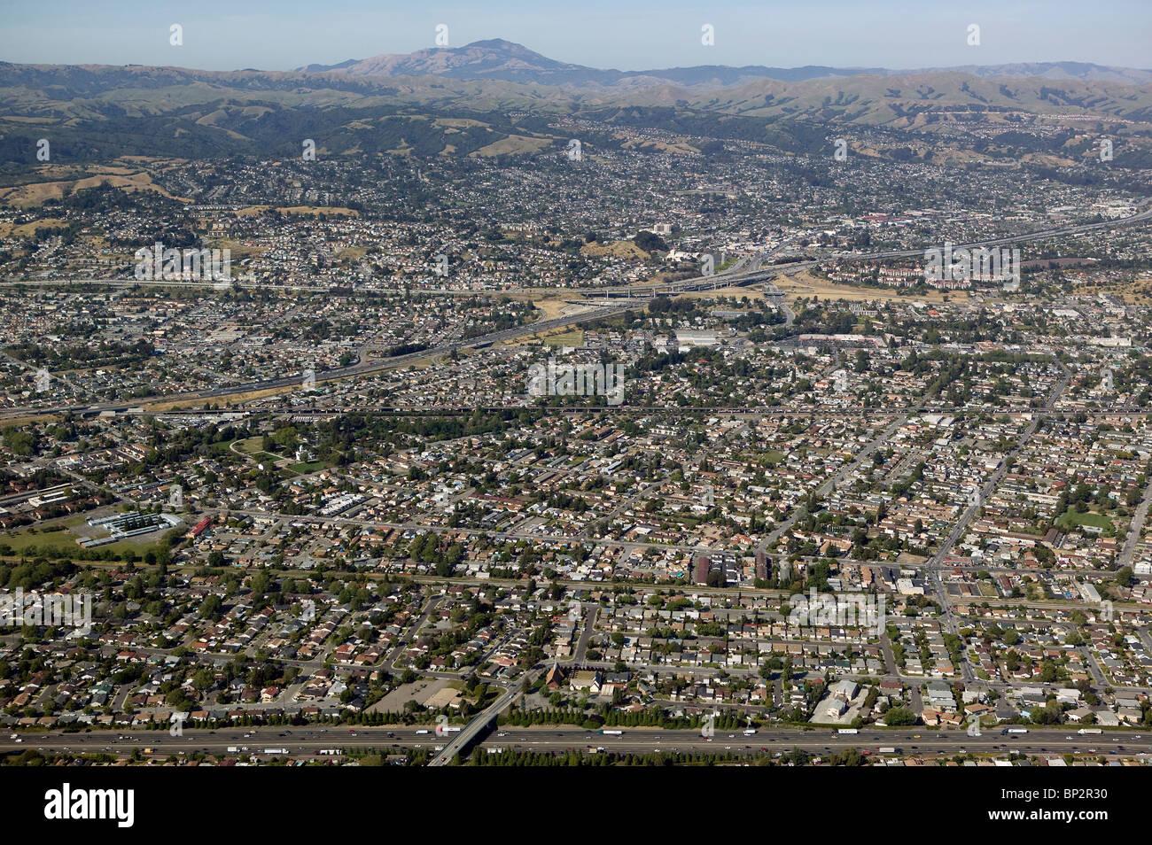 aerial view above housing density along Hayward fault Hayward California - Stock Image