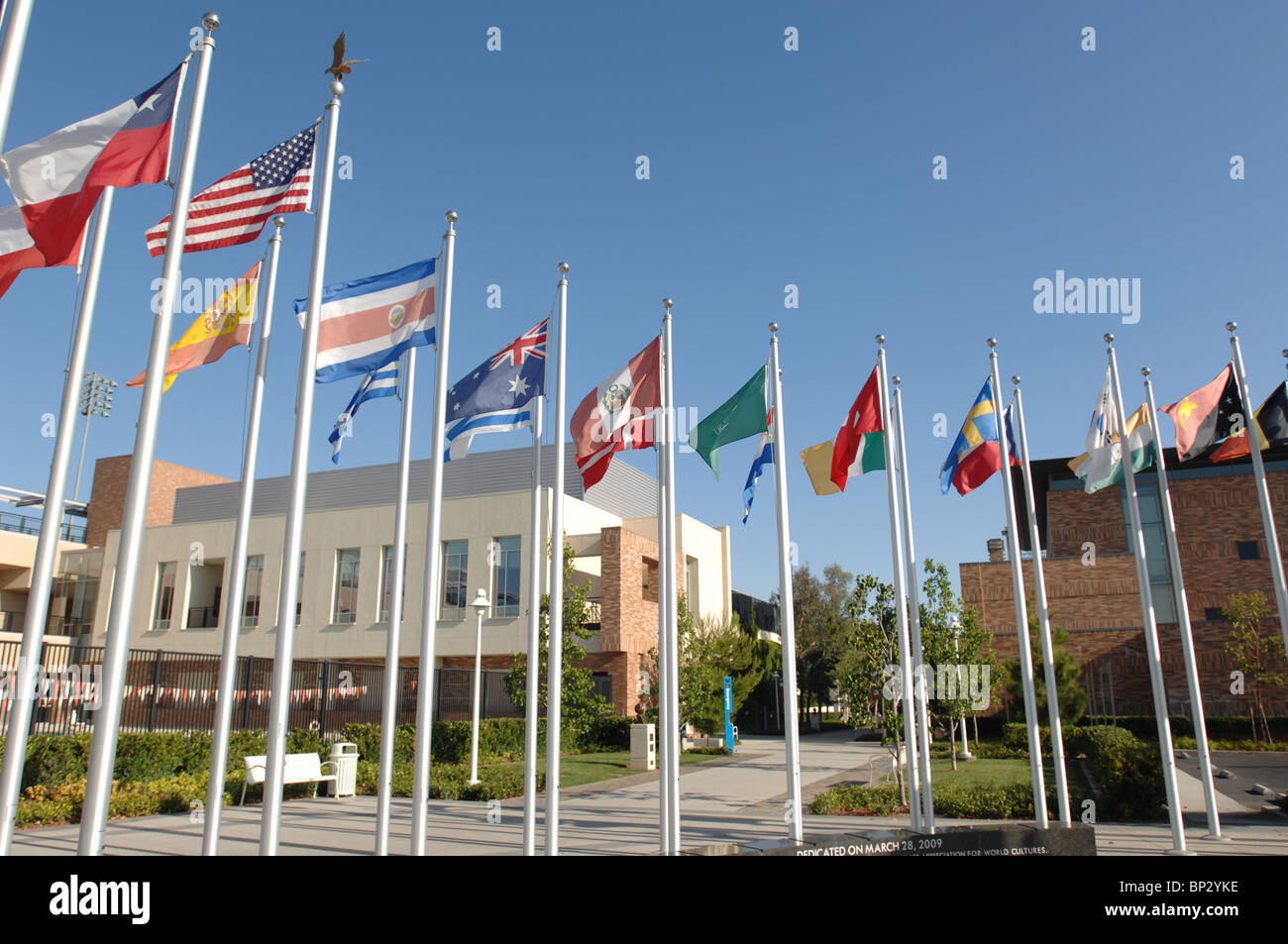 Chapman University's  Global Citizen's Plaza Fountain with flags of many nations. - Stock Image