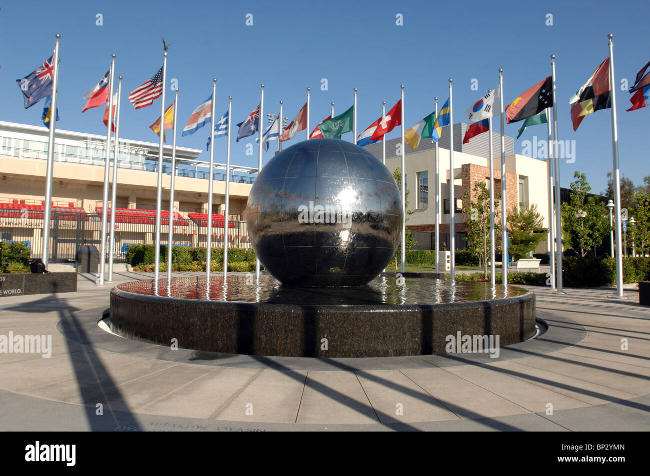 Chapman University's  Global Citizen's Plaza Fountain with flags of many nations and a globe which rotates - Stock Image