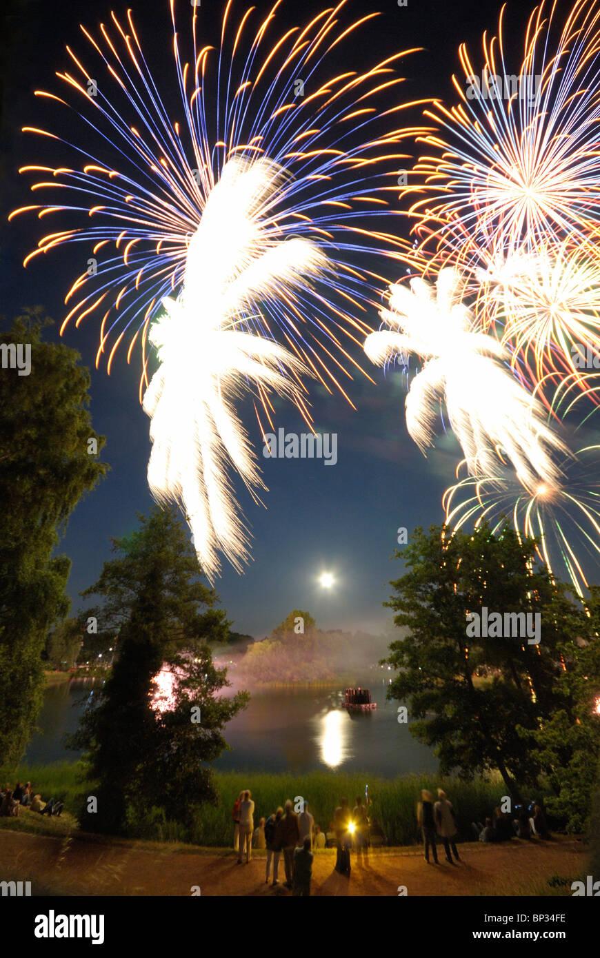 Midsummer night. Fireworks and moon over the lake, BUGA Park, Bundesgartenschau Park, Britzer Garten,  Britz, Neukoelln, - Stock Image