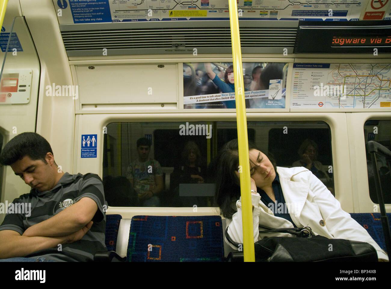 Falling asleep on the late night tube train - Stock Image