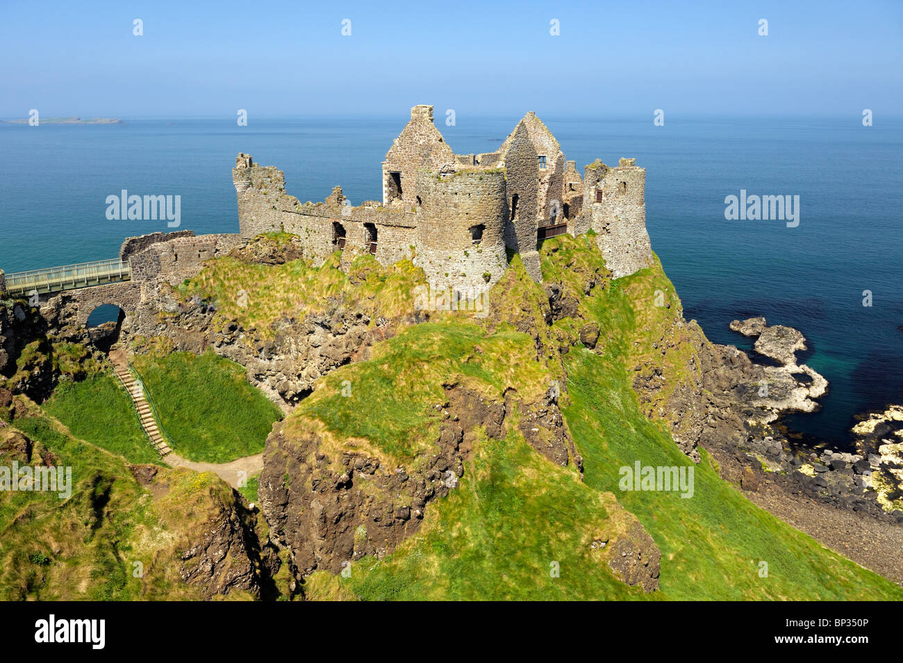 Dunluce Castle, mediaeval ruin between Portrush and Bushmills on North Antrim Coast Road, County Antrim, Northern - Stock Image